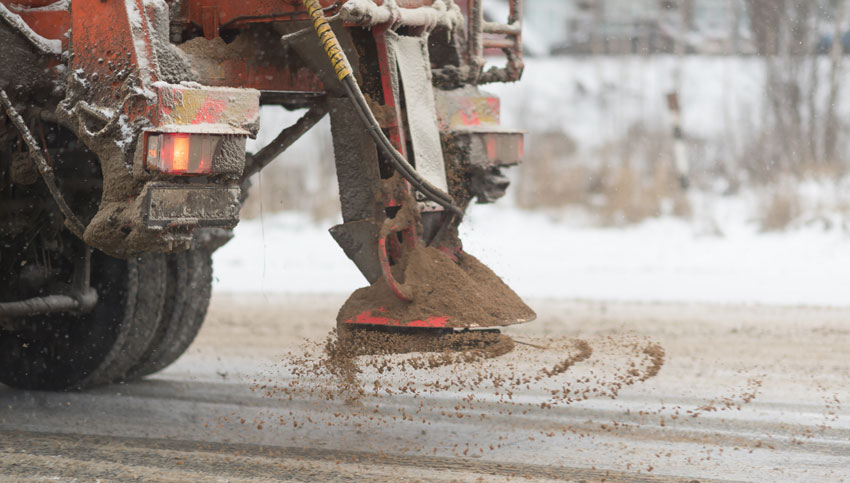 salt and sand spreading on winter roads